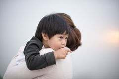 Mother hugging a little boy points his finger Royalty Free Stock Photography