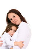Mother hugging little girl Stock Photos