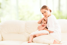 Mother hugging and protects her baby  daughter Royalty Free Stock Photography