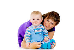 Mother hugging a small child Stock Images