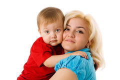 Mother hugging son Stock Images
