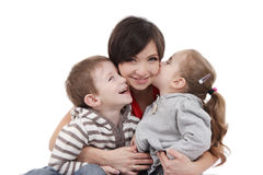 Mother hugging two children over white Royalty Free Stock Image