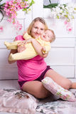 Mother hugs child Stock Photo