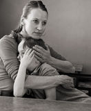 Mother hugs crying son. Mother comforts her crying 6-year old son, low-key monochrome portrait Royalty Free Stock Photo