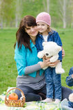 Mother hugs daughter at a picnic Royalty Free Stock Photos
