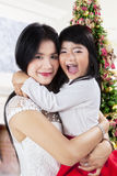 Mother hugs her daughter in christmas day Royalty Free Stock Photography