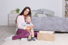 Mother hugs her little son in cozy bedroom Royalty Free Stock Photos