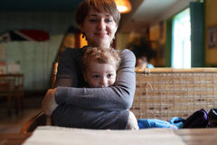 Mother hugs her son Stock Image