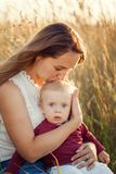 Mother hugs and kisses his little son in summer sunny day. Concept of happiness and tenderness.  Royalty Free Stock Photos