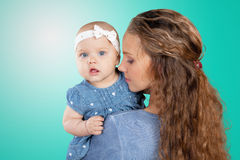 Mother hugs a young child Royalty Free Stock Images