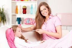Mother with ill child Stock Image