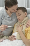 Mother and ill son Stock Photo