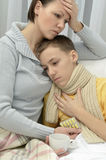 Mother and ill son Royalty Free Stock Photo