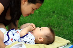 Mother and infant. Mother looking at her infant and take care Royalty Free Stock Photography