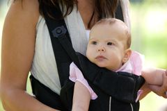 Mother with infant baby in sling Royalty Free Stock Photo