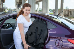 Mother installing child restraint seat in the car. Mother installing child restraint seat in the vehicle Stock Photos