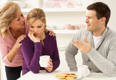 Mother Interferring With Couple Having Argument. Senior Mother Interferring With Couple Having Argument At Home Stock Photos