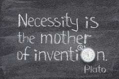 Mother of invention. Necessity is mother of invention quote of ancient Greek philosopher Plato written on chalkboard with vintage precise stopwatch used instead stock photo