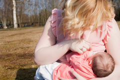 Mother Is Giving Her Baby Breastfeeding Royalty Free Stock Photo