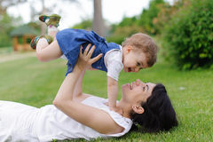Mother and Jumping Girl Royalty Free Stock Images