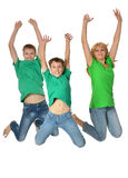 Mother jumping with sons. Against on white background Stock Image