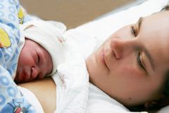 Mother and just born baby Stock Images