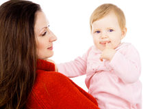 Mother keep is a little baby, a happy family Stock Photography