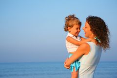 Mother Keeps Child At Hands Of Edge Of Sea Royalty Free Stock Photos
