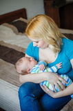 Mother keeps a little baby boy in her arms Stock Image