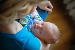 Mother keeps a sleep little baby boy in her arms Royalty Free Stock Photo