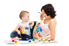 Mom with child boy painting Royalty Free Stock Photos