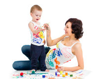 Mom with son kid painting Royalty Free Stock Photos