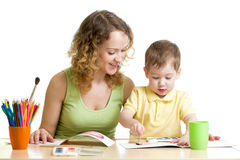 Mother and kid boy paint together Stock Images