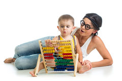 Mother and kid boy play with counter toy Stock Images