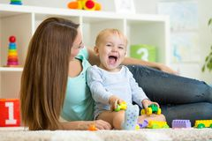 Mother and kid boy play together indoor Royalty Free Stock Images