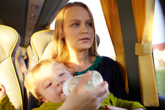 Mother with kid in the bus. Stock Photo