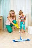 Mother and kid clean room Royalty Free Stock Photography