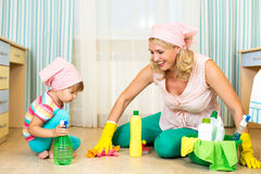 Mother and kid cleaning room Stock Photography