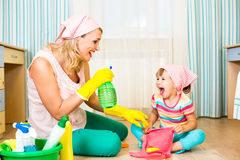 Mother and kid cleaning room and having fun Stock Photo
