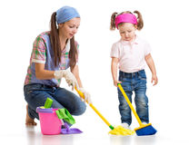 Mother with kid cleaning room and having fun Stock Photography