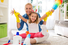 Mother and kid cleaning room Stock Images
