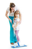 Mother and kid cleaninng room Royalty Free Stock Image
