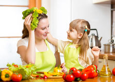 Mother and kid cooking and having fun in kitchen Stock Image