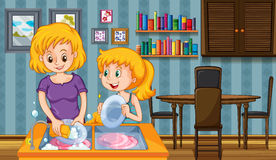Mother and kid doing dishes together Royalty Free Stock Photography