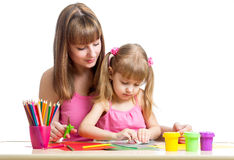 Mother and kid girl draw and cut together Royalty Free Stock Image