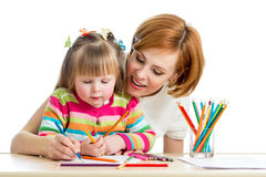 Mother and kid girl draw pencils together Stock Photos