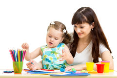 Mother and kid girl draw together Royalty Free Stock Photos