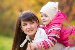 Mother with kid girl outdoors in fall Stock Image