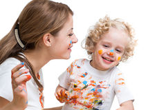 Mother and kid girl painting together Stock Photography