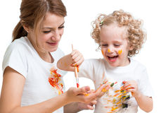 Mother and kid girl painting together Stock Photo